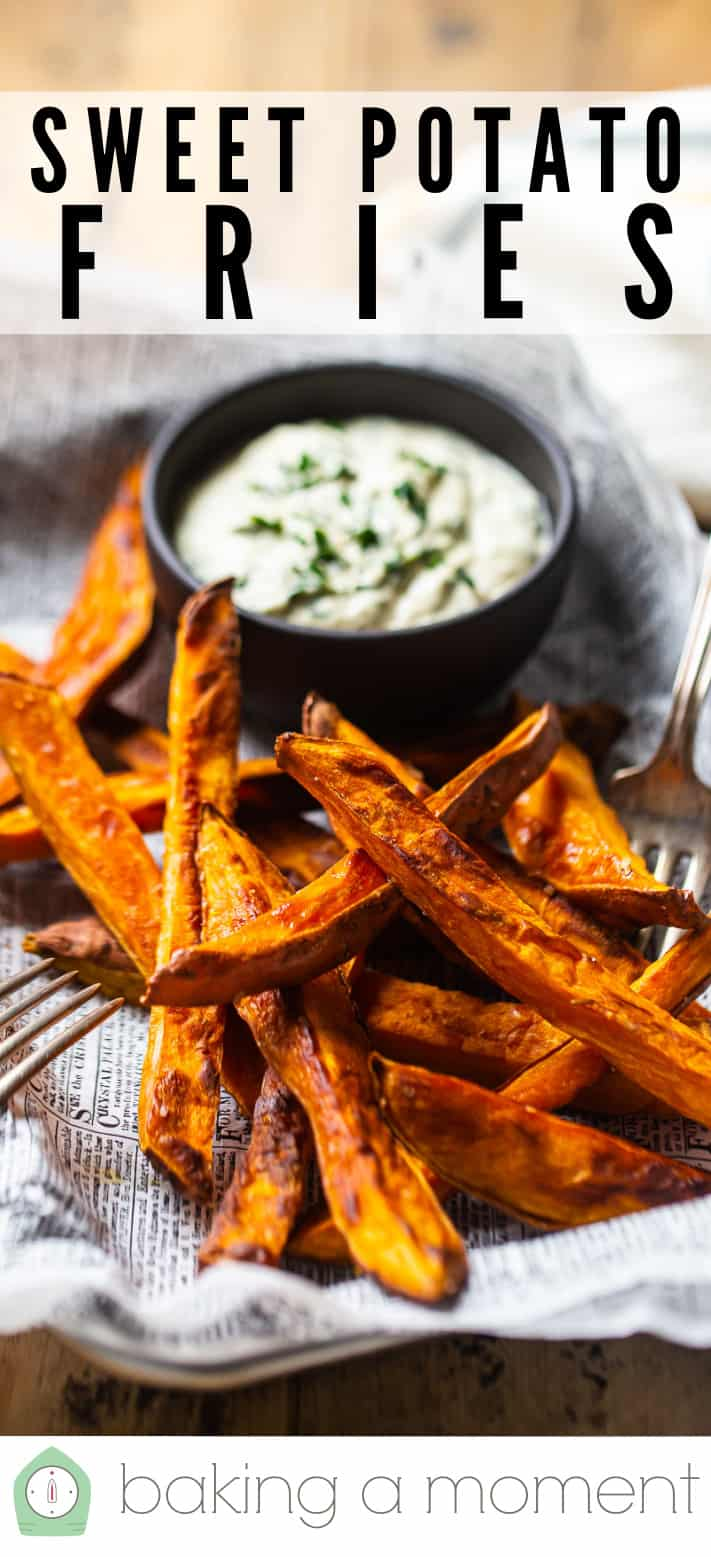 "Baked sweet potato fries on a tray with a bowl of dipping sauce & a text overlay above that reads ""Sweet Potato Fries."""
