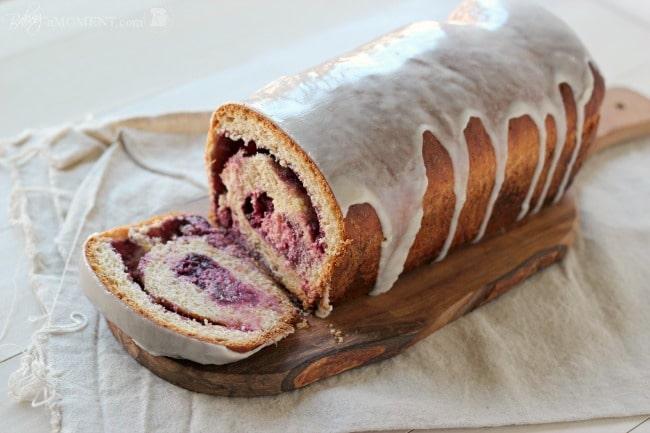 Whole Wheat Blackberry Cream Cheese Swirl Bread with Vanilla Bean Glaze | Baking a Moment