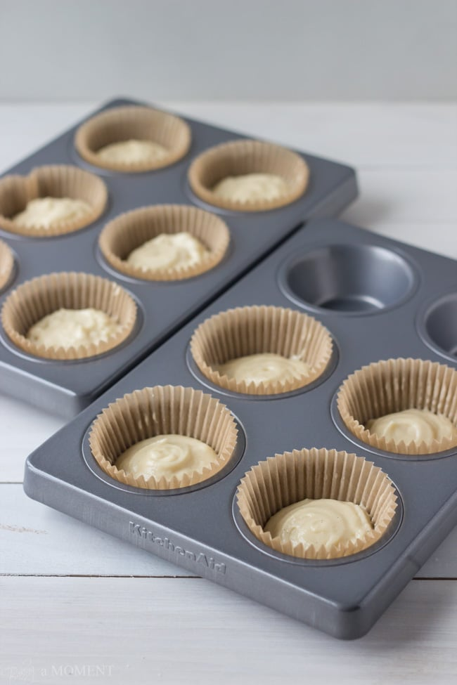 Unbaked vanilla cupcakes in cupcake pan.