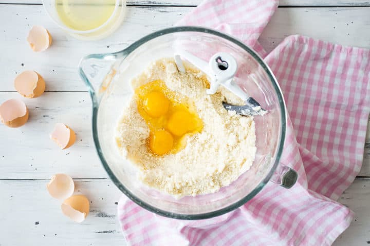 Adding eggs to dry ingredients and butter make yellow cake.