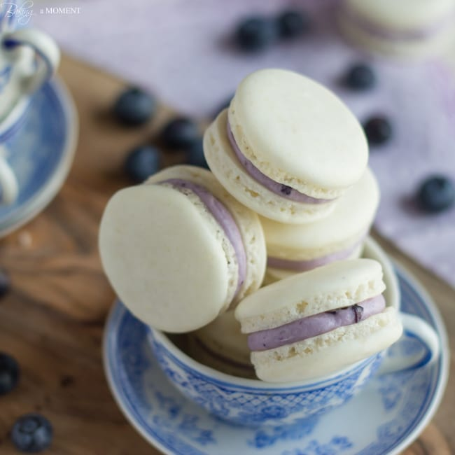 Delicate Almond French Macarons are Sandwiched with a Rich and Creamy Blueberry Mascarpone Filling. A Fresh way to enjoy Seasonal Summer Berries!