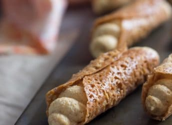 Such a fun Fall treat! Pumpkin Cannoli with a creamy, spiced filling & a nutty almond brittle shell
