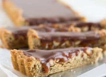 OMG! Snickers Blondie Tart- peanut butter blondie base filled with crunchy peanuts, salted caramel, and milk chocolate ganache! I just about died.