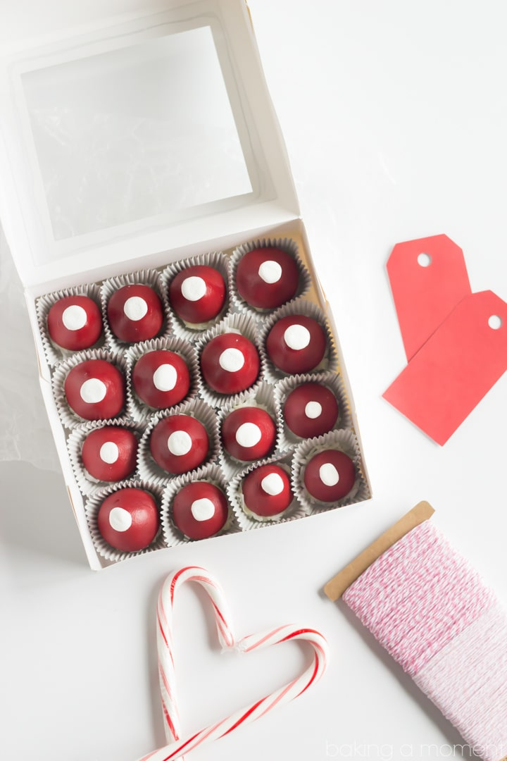 Red Velvet Cookie Dough Truffles in the shape of a Santa hat!  How cute!  Making these to give as gifts.  #TasteTheSeason #ad