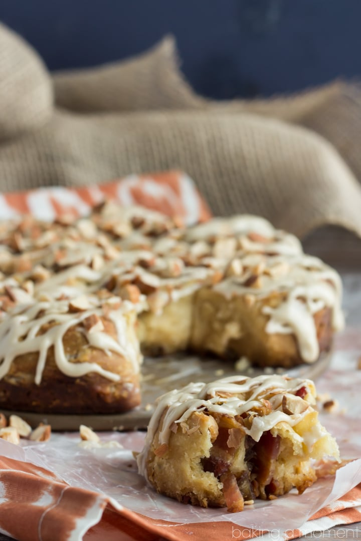 Angel Biscuits are like a fluffy buttermilk biscuit but with the gooiest, most delicious yeasty flavor. This version is rolled up with bacon and dates, drizzled with a maple glaze, and sprinkled with crunchy almonds. Swoon!