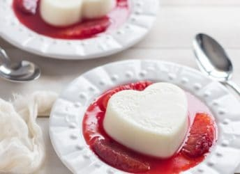 Coconut White Chocolate Panna Cotta with Blood Oranges- so pretty yet SO EASY! Start these now and you'll be enjoying them in 2 hours or less ;)