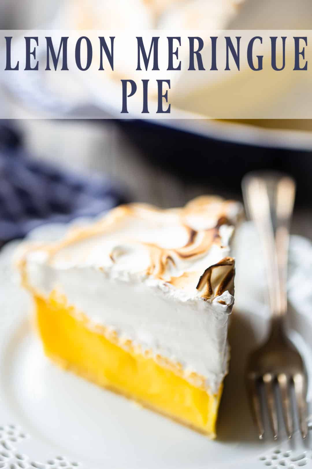 "Lemon meringue pie recipe, prepared, sliced, and served on a plate with a text overlay above that reads ""Lemon Meringue Pie."""