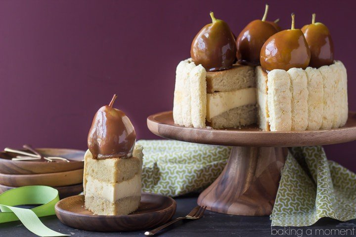 Pear Caramel Charlotte, by Baking a Moment: layers of vanilla brown sugar cake, sandwiched around a pear caramel mousse, surrounded by ladyfingers and crowned with caramel-dipped pears.