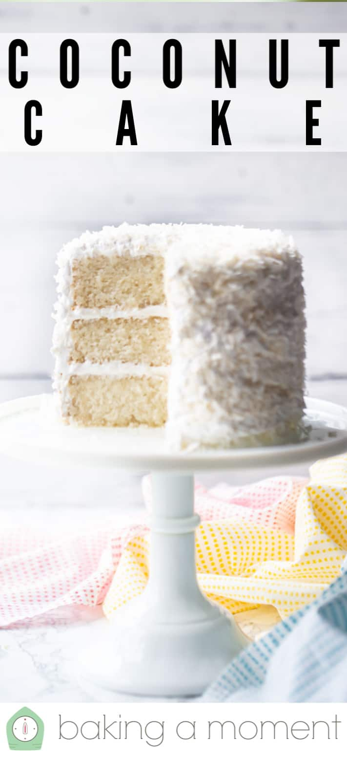 Coconut cake recipe served on a white pedestal with shredded coconut.