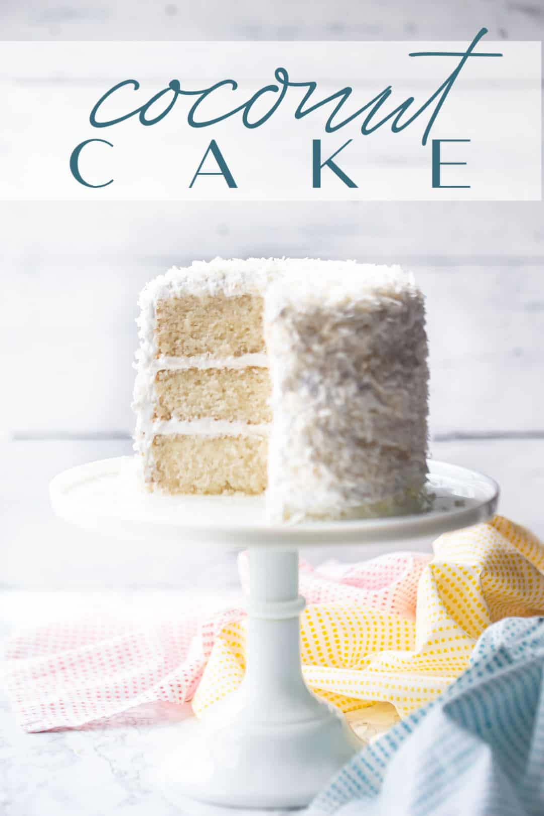 "Triple layer coconut cake recipe, baked and served on a white pedestal with a text overlay above reading ""Coconut Cake."""