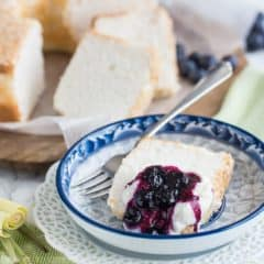 Classic Angel Food Cake: perfectly sweet & light as a cloud, served with fresh whipped cream and a citrus-y blueberry lemongrass topping.