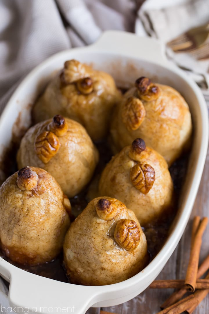 Soft baked pears encased in tender, buttery pastry, swimming in a sweet cinnamon sauce- these Pear Dumplings are fall comfort on a plate!