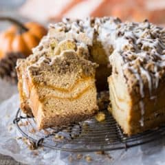 Pumpkin Spice Coffee Cake: moist sour cream coffee cake infused with pumpkin spice, ribboned with pumpkin and topped with a crunchy cinnamon crumb topping. Perfect for fall! #PumpkinDelight #IDelight @indelight #ad