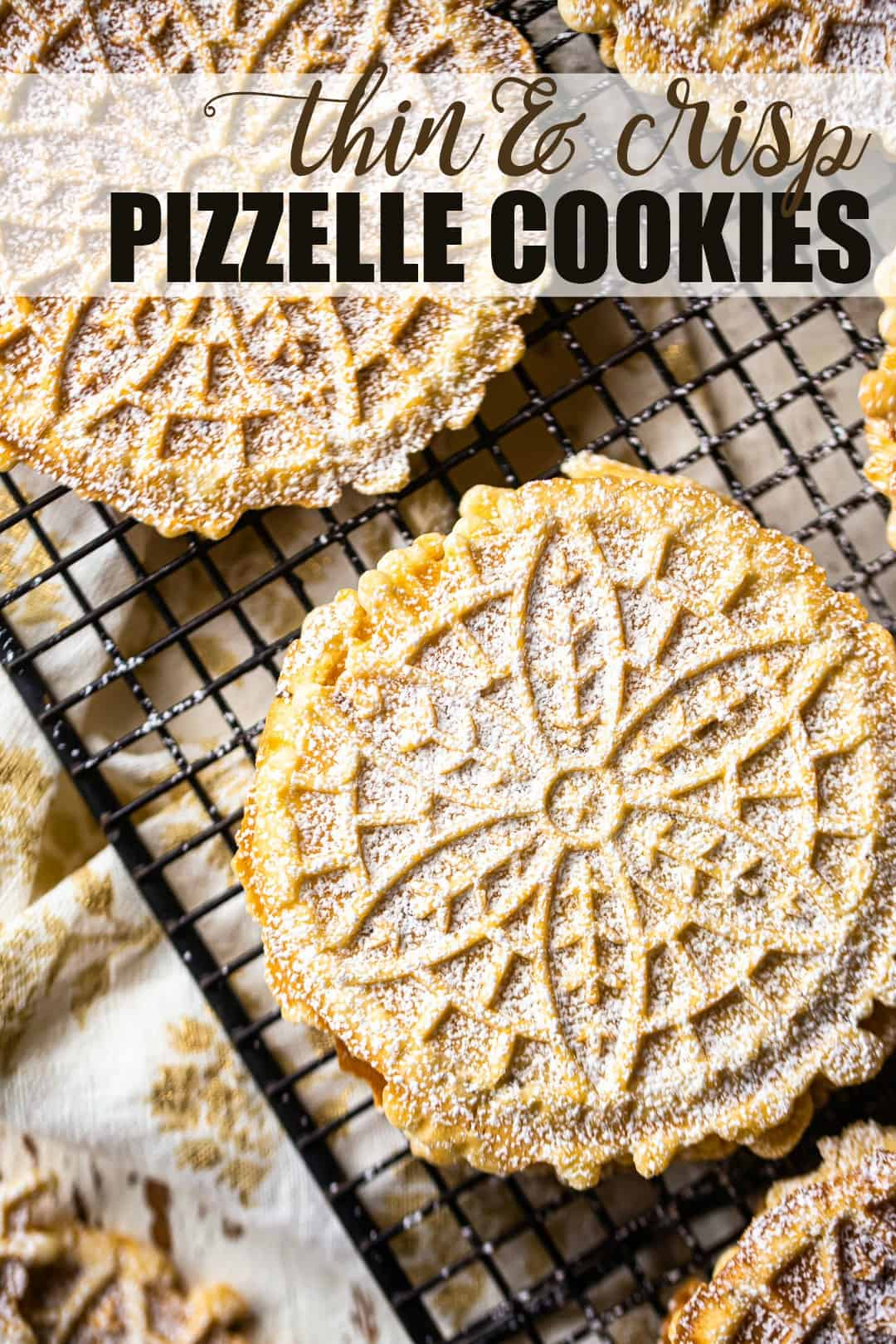 "Perfect pizzelle recipe, prepared and arranged on a wire rack, with a text overlay above that reads ""Thin & Crisp Pizzelle Cookies."""