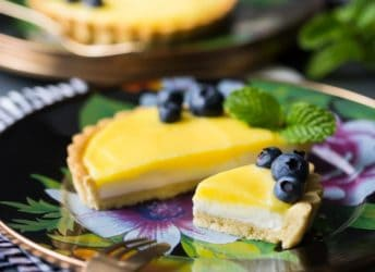 Lemon Cheesecake Tarts: with a buttery shortbread crust, a fluffy no-bake cheesecake base, and tangy lemon curd. One of the best desserts I've ever had! food desserts lemon #ad @mackenziechilds