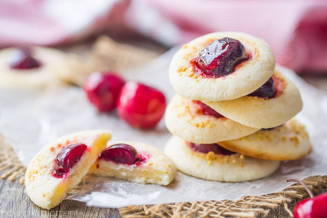 Cherry Cheesecake Thumbprint Cookies: the cream cheese cookie was SO good with the glazed cherry!  Loved the little sprinkling of crunchy graham cracker crumbs too.  This recipe is definitely a keeper!  food desserts cookies