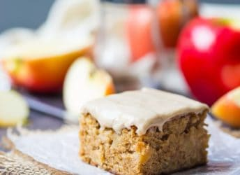 Maple Iced Apple Blondie on a napkin with apples in the background
