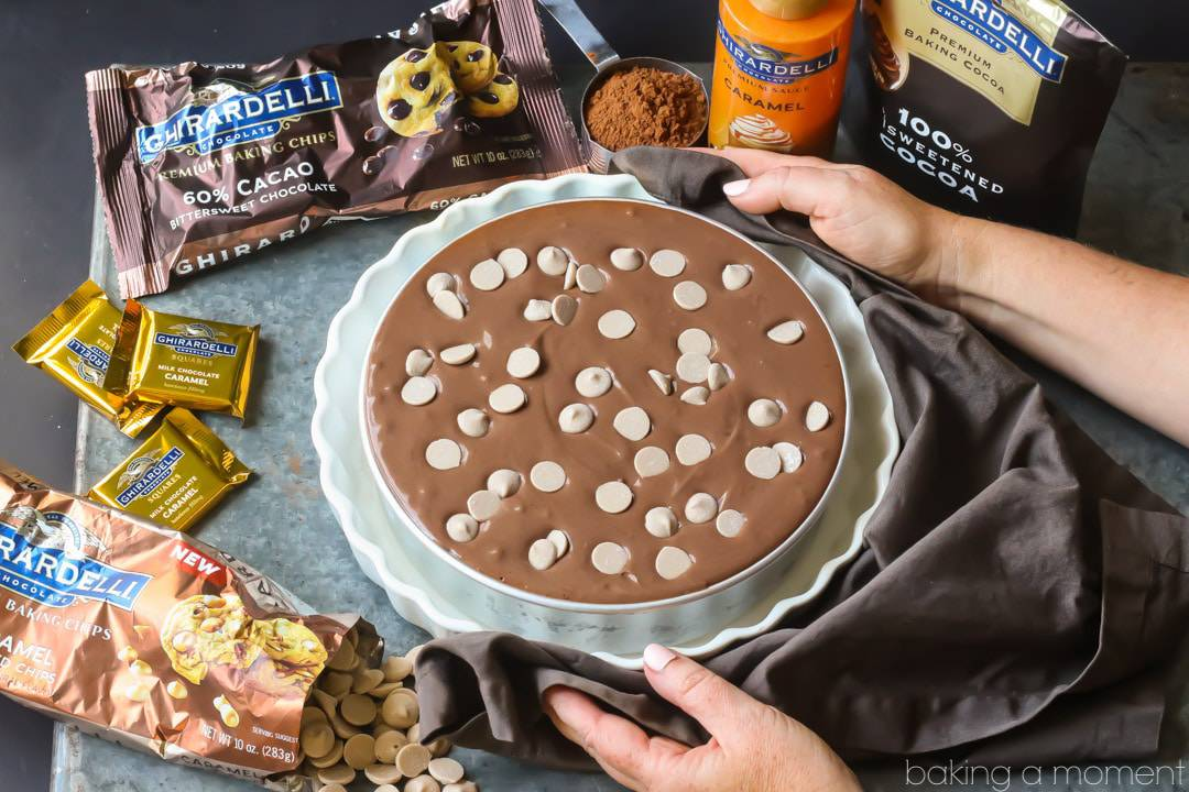 Chocolate Caramel Chip Cheesecake: unbaked cheesecake in water bath, with Ghirardelli ingredients in background. food desserts chocolate