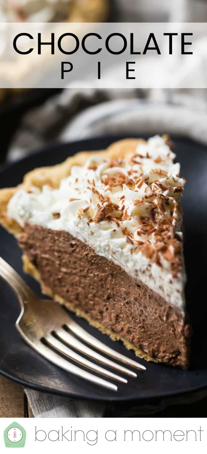 "Close up image of a slice of homemade chocolate cream pie on a dark plate with a silver fork and a text overlay above that reads ""Chocolate Pie."""