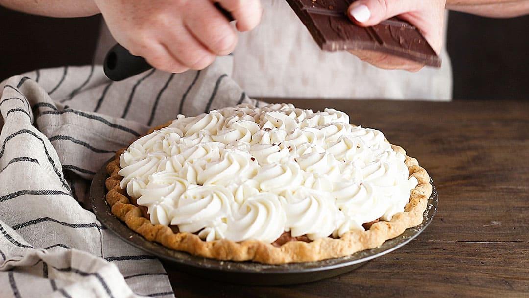 Garnishing chocolate pie with shavings of chocolate.