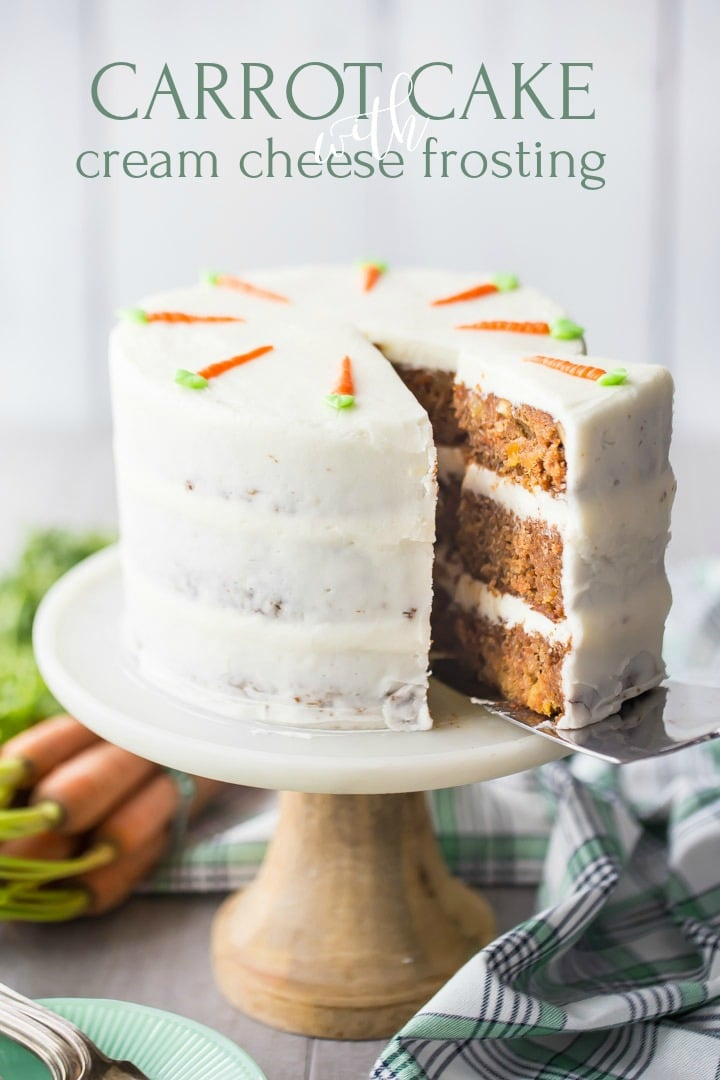Cake server removing a slice of triple-layer carrot cake with cream cheese frosting, with a green plaid cloth below, fresh carrots in the background, and a text overlay.