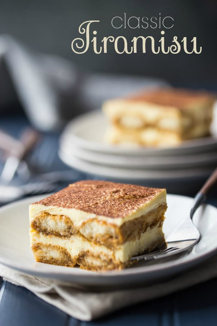 Vertical image with text overlay of two slices of tiramisu presented on white plates with a dark blue background.