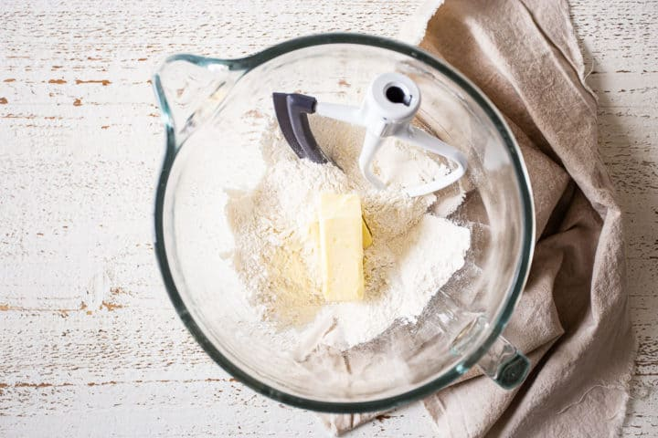 Dry ingredients in a large bowl with softened butter.