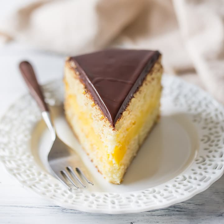 Slice Of Boston Cream Pie With Moist Vanilla Cake Sandwiched Around Rich Pastry Filling