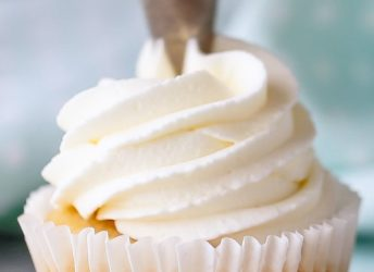 Whipped cream frosting: pipes well and can be made ahead! Perfect for cupcakes and cakes.
