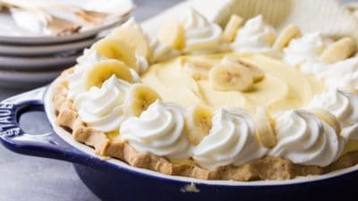 Banana Cream Pie with fluffy diplomat cream filling, real bananas, and sweet whipped cream, nestled into a flaky homemade pie crust.