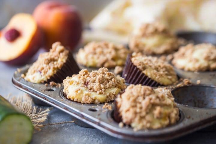 Crumb Topped Zucchini Peach Muffins
