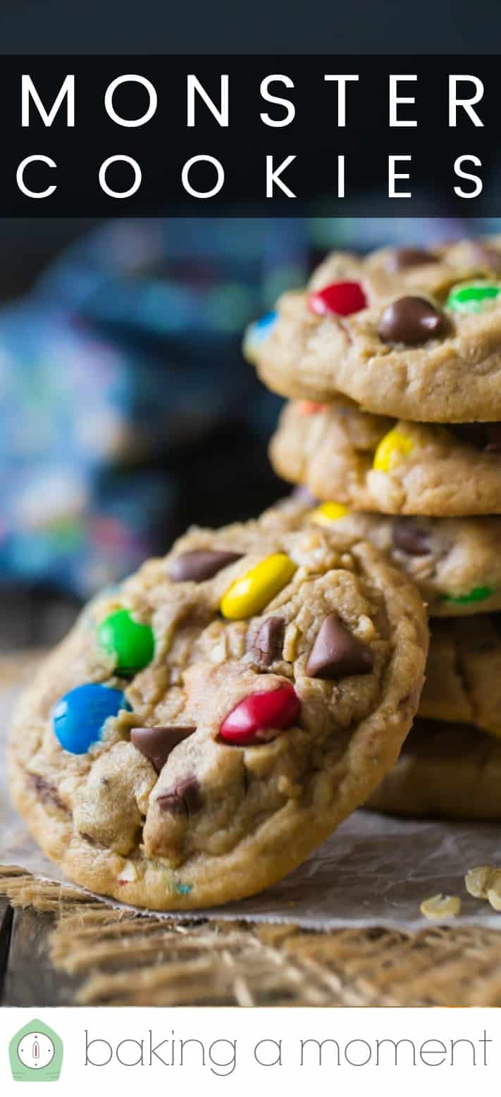 """Close-up of a stack of soft monster cookies with oatmeal and m&m's, with a text overlay above that reads """"Monster Cookies."""""""