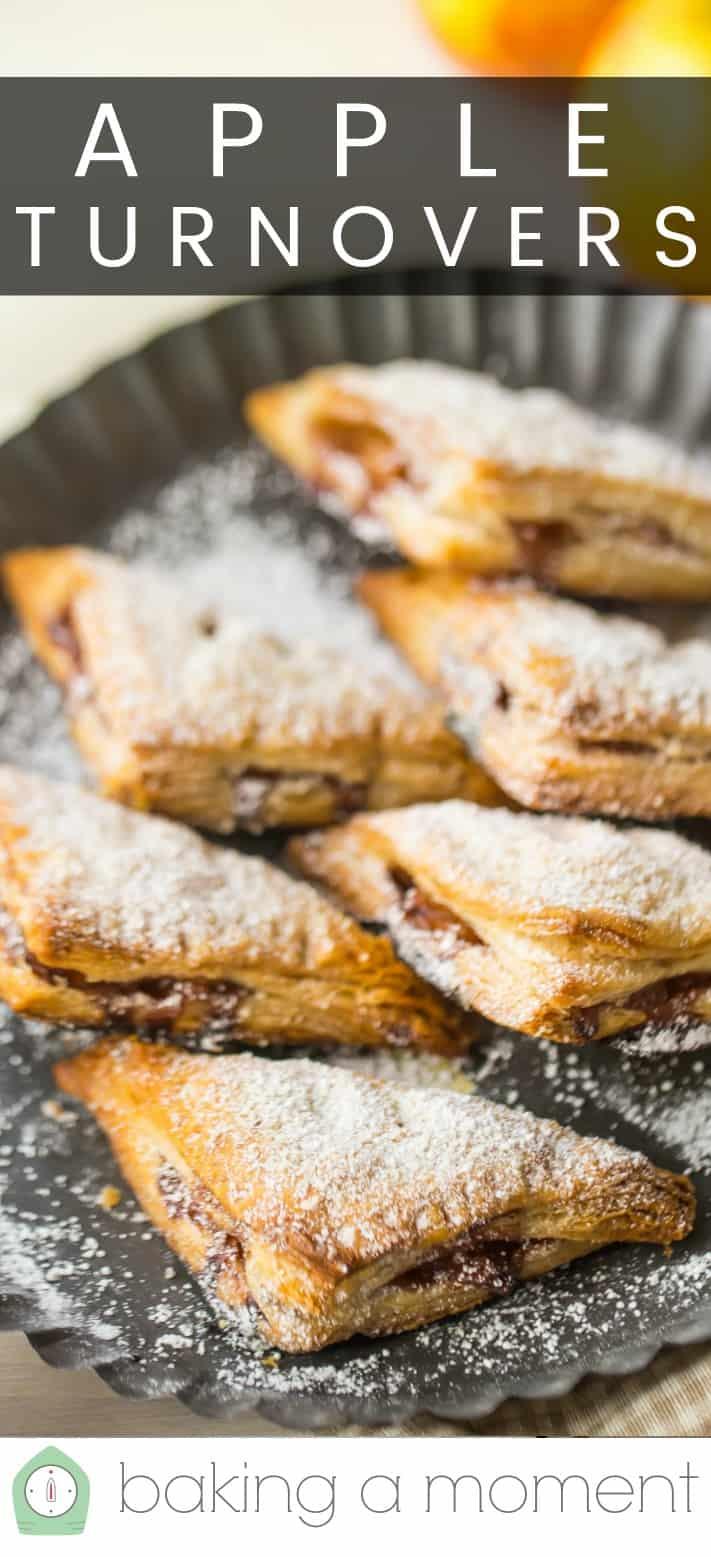 "Six apple turnovers in a fluted metal pan with powdered sugar, and a text overlay above that reads ""Apple Turnovers."" data-pin-description="