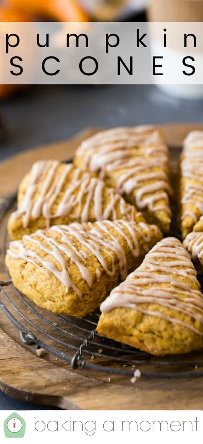 "Close-up image of moist pumpkin scones on a wire cooling rack, with a text overlay above reading ""Pumpkin Scones."""