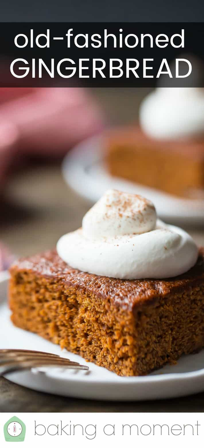 """Close-up image of a piece of old-fashioned gingerbread cake, with a dollop of whipped cream on top and a text overlay that reads """"Old-Fashioned Gingerbread."""""""