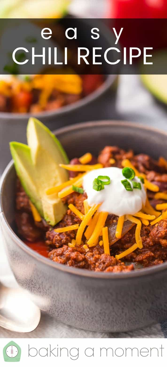 "Close-up image of a bowl of chili, topped with cheese, sour cream, and avocado, with a text overlay reading ""Easy Chili Recipe."""