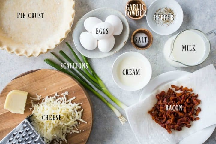 Overhead shot of all the ingredients needed to make quiche Lorraine.