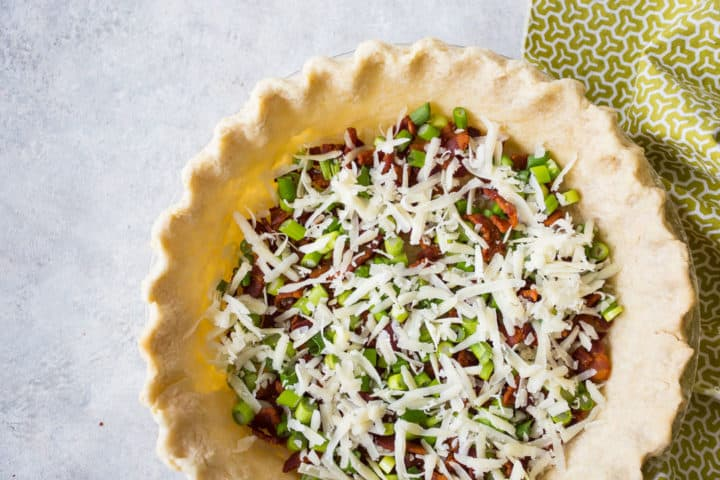 Bacon, scallions, and cheese in a blind baked pie crust.