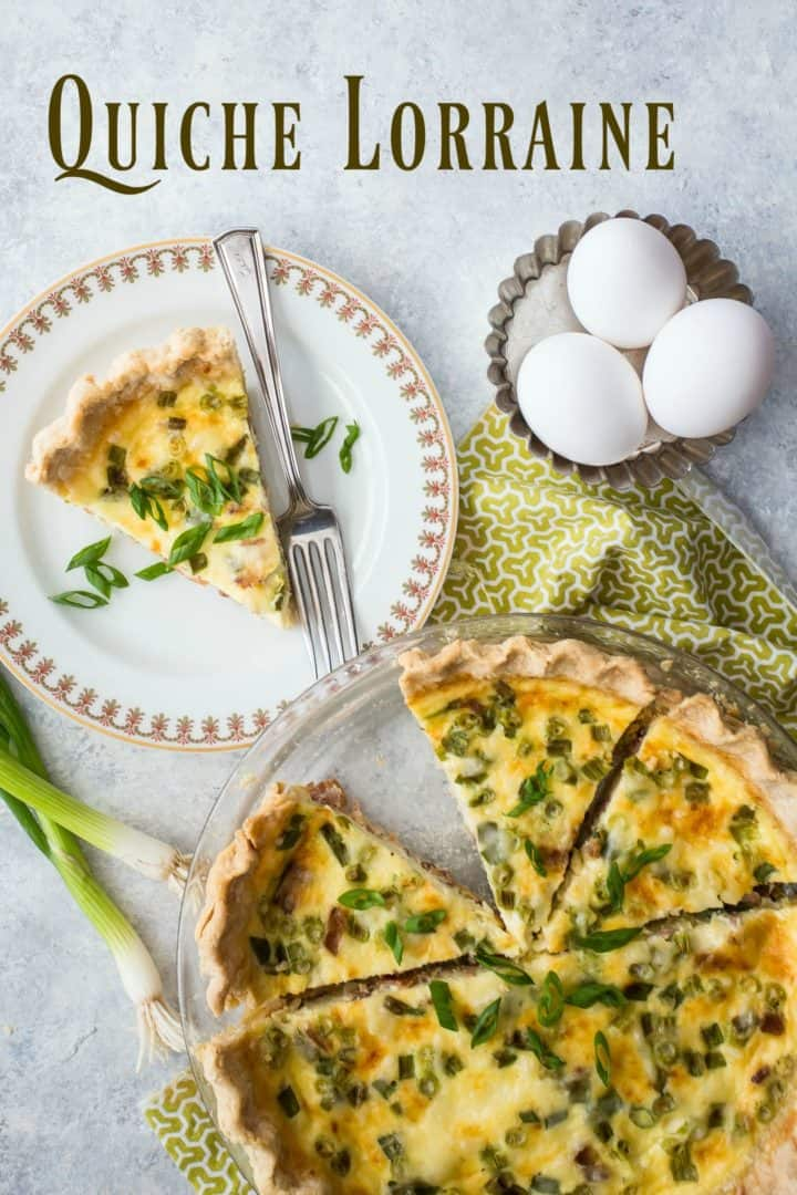 Overhead shot of quiche Lorraine cut into slices with eggs and scallions.