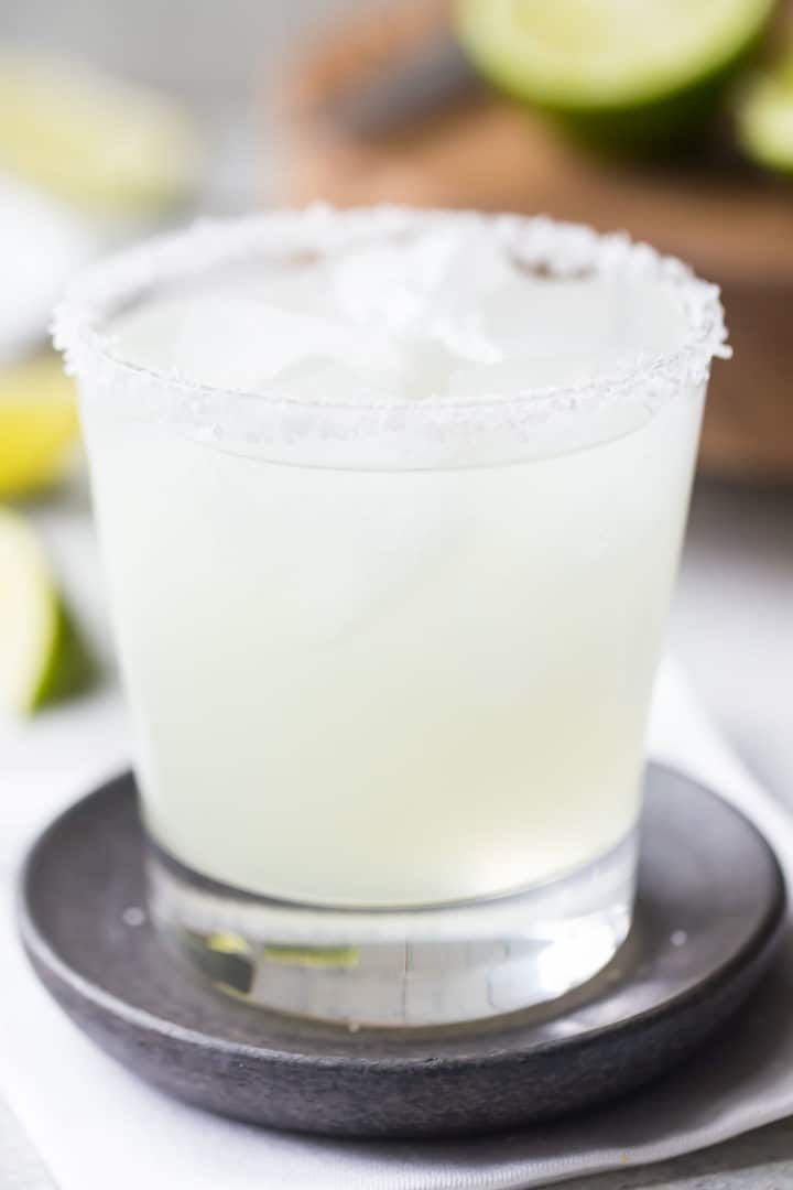 Perfect margarita cocktail in a rocks glass with a salted rim.