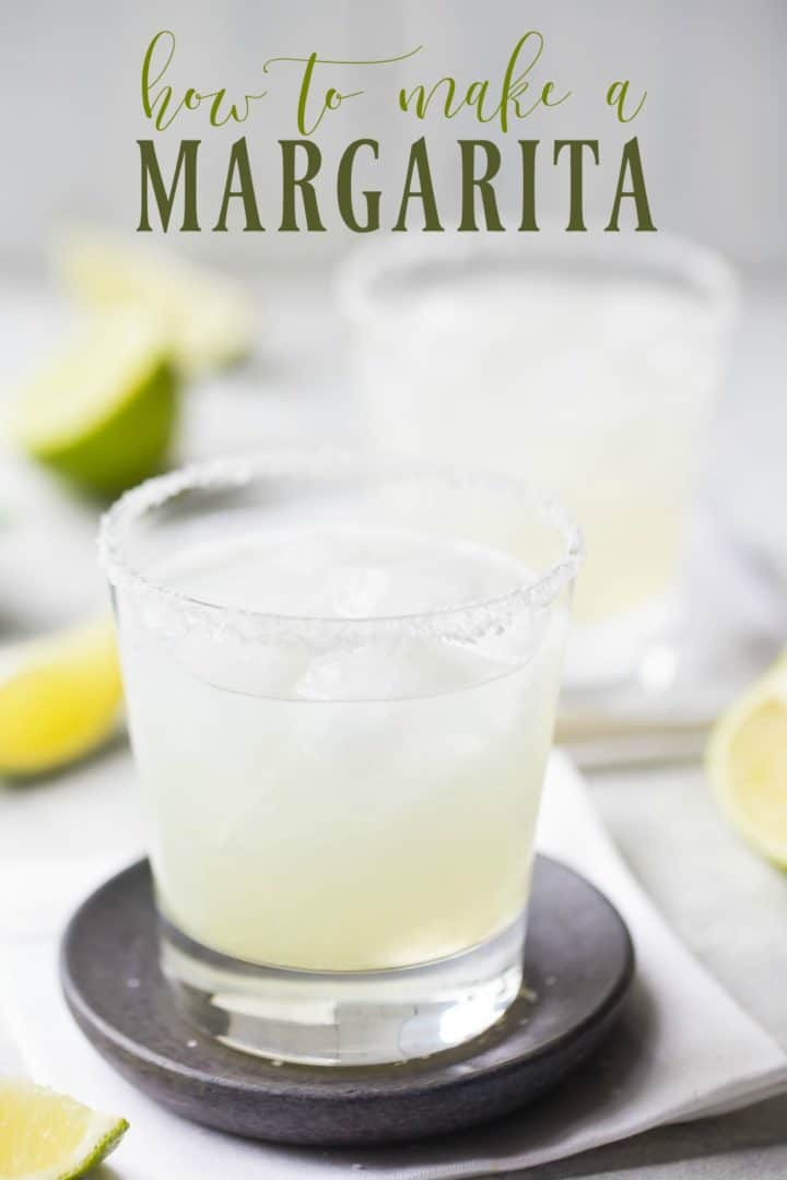 "Two margaritas in rocks glasses with salted rims and a text overlay reading ""How to make a Margarita."""