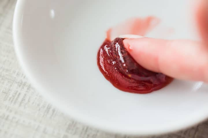 Pushing jam on a cold saucer to see if it will set properly.