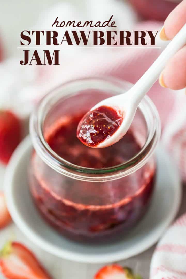 "Spooning homemade strawberry jam out of a jar, with a text overlay reading ""Homemade Strawberry Jam."""