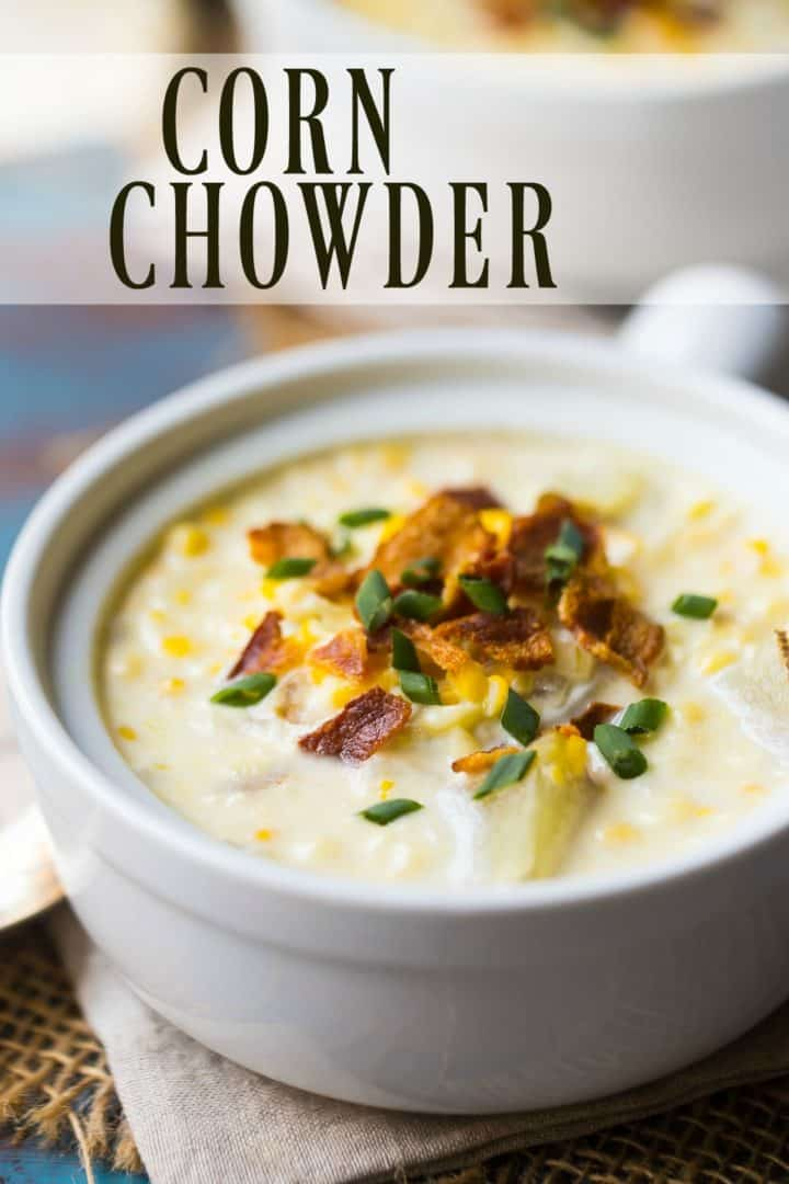 "Corn chowder with bacon and chives in a white crock, with a text overlay reading ""Corn Chowder."""