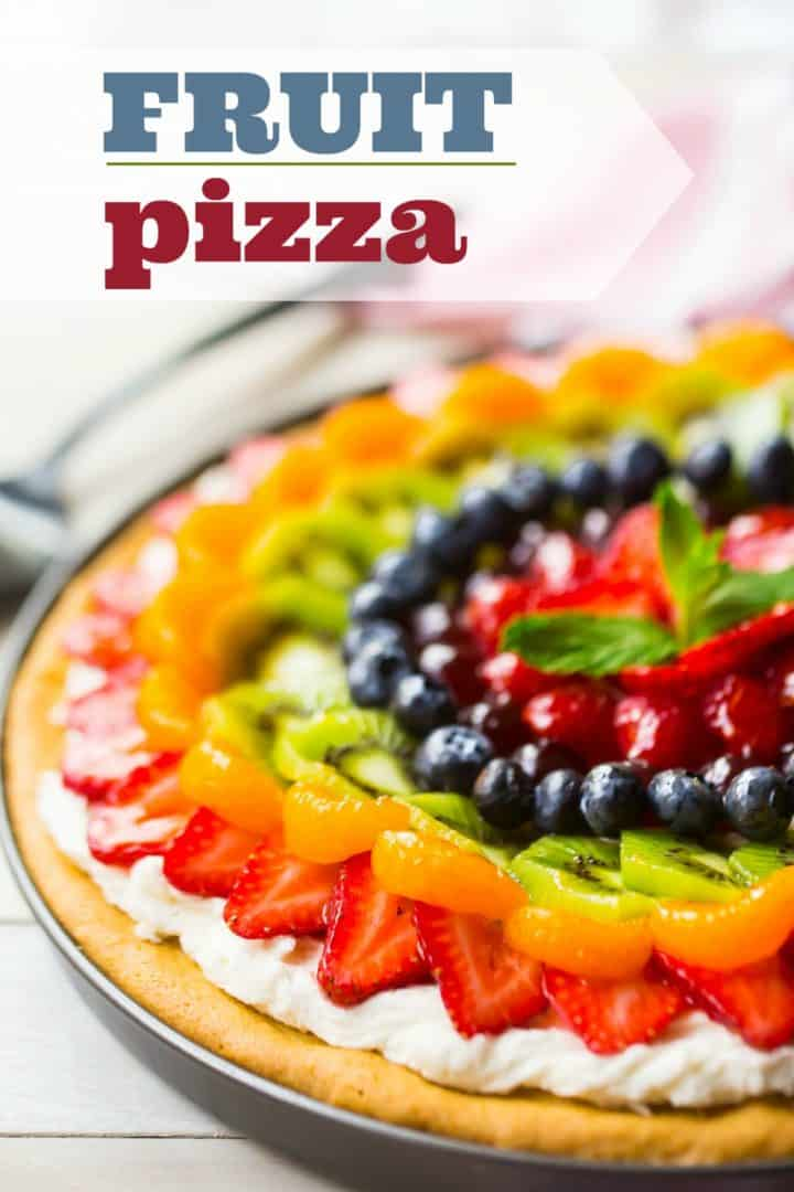 "Glazed fruit pizza on a white background with a text overlay reading ""Fruit Pizza."""