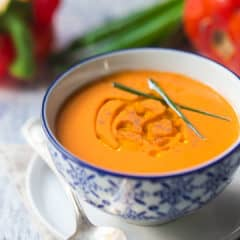 Authentic Spanish gazpacho in a blue porcelain bowl.