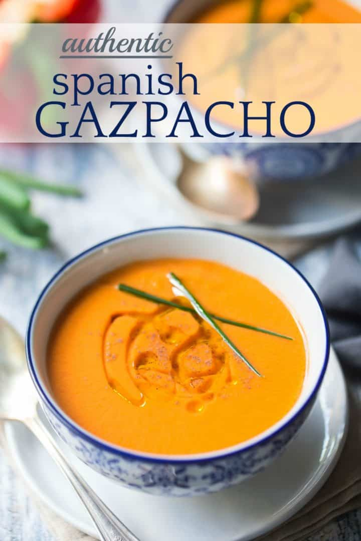 "Bowl of gazpacho soup with olive oil, pepper, and chives, with a text overlay reading ""Authentic Spanish Gazpacho."""