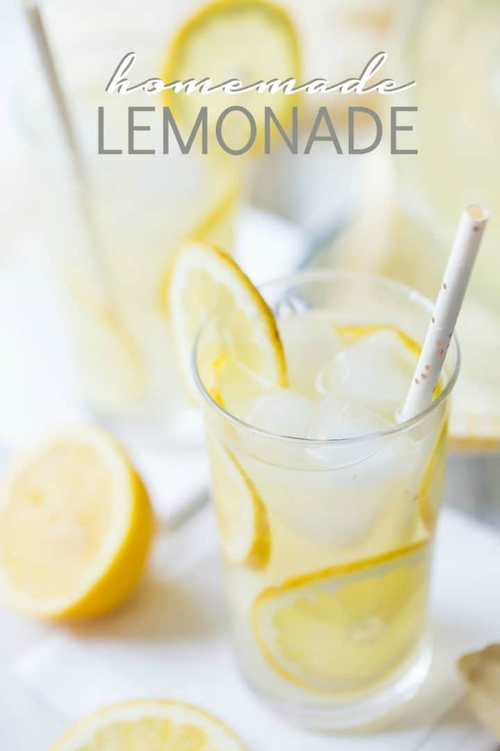 "Glasses of homemade lemonade with slices of lemon, ice, and paper straws, with a text overlay reading ""Homemade Lemonade."""