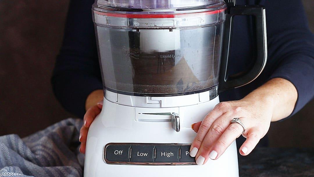 Making Oreo pie crust in the food processor.