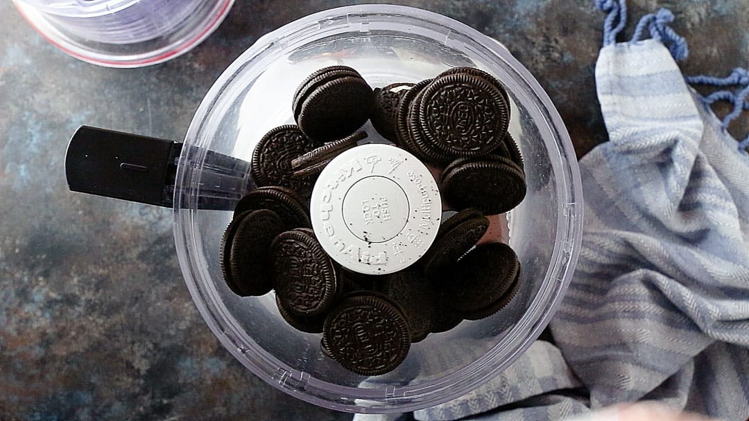 Oreo cookies in the bowl of a food processor.